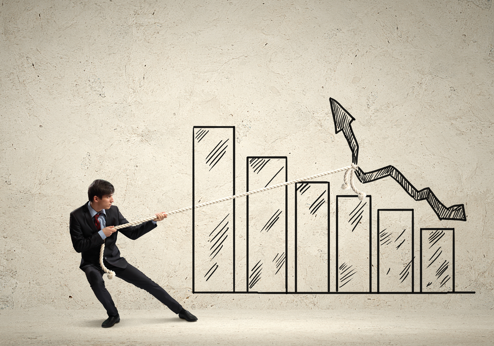 Image of young businessman pulling graph. Chart growth concept-1