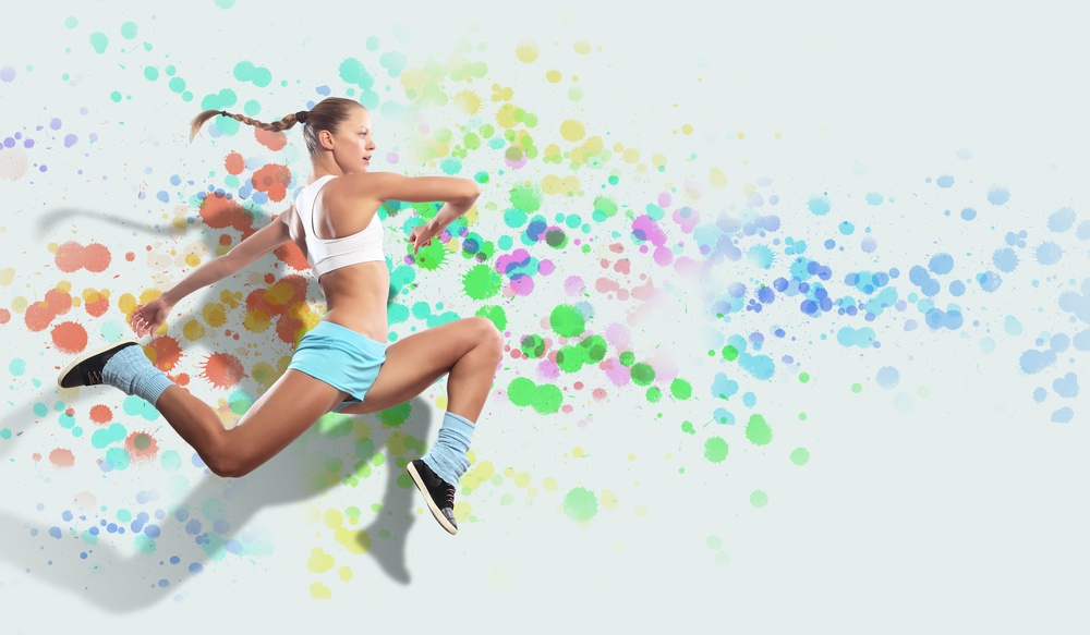 Image of sport girl in jump against color spot background